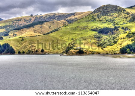 Hills of New Zealand. View from Otago Harbor bay.
