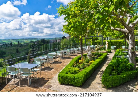 Hills, vineyards and cypress trees, Tuscany landscape from a restaurant terrace near San Gimignano, Italy
