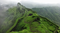 Hilltop stone bridge, ancient fort, green nature background aerial view of mountain landscape