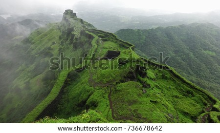 Hilltop stone bridge, ancient fort, green nature background aerial view of mountain landscape #736678642