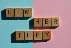 Him, Her, They, gender pronouns, words in wooden alphabet letters on pink and blue background
