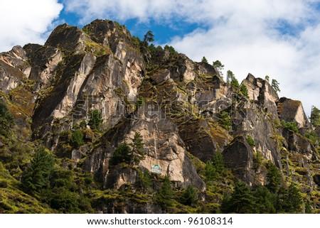 Himalaya Landscape: rocks, trees and Buddhist symbols. Travel to Nepal