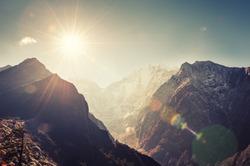 Himalaya mountains at sunrise. Lens flare effect. Khumbu valley, Everest region, Nepal.