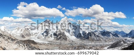 himalaya, panoramic view of himalayas mountain, Mount Everest with beautiful sky and Khumbu Glacier - way to Everest base camp, Khumbu valley, Sagarmatha national park, Nepalese himalayas #699679042