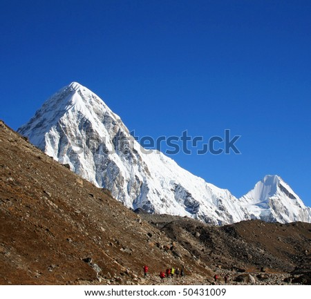 Himalayan mountain landscape with trekkers, Mt. Pumori, Nepal, Everest Region