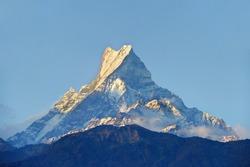 Himalayan mountain peak during sunrise ( Machapuchare or Fishtail peak in Nepal )