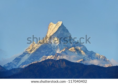 Himalayan mountain peak during sunrise ( Machapuchare or Fishtail peak in Nepal )