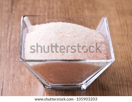 Himalayan pink salt in small bowl of glass.
