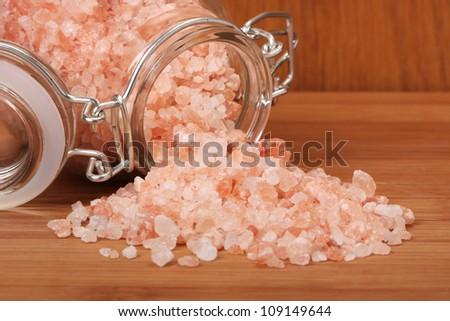 Himalayan pink salt in small jar of glass.