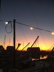 Hindeloopen, The Netherlands - Yacht racing at it's best with these Lemsteraken. Enjoying a sundowner at sundown - September 2019