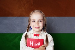 Hindi concept with little girl student against the India flag background. Learn hindi language