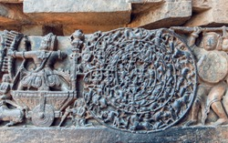 Hindu epic Mahabharata scene in carvings. Story of warrior Abhimanyu entering the Chakravyuha on stone artworks of the 12th century Hoysaleshwara temple in Halebidu, India.