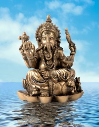 Hindu God Ganesh over de water whith a blue sky