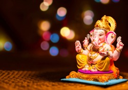 Hindu God Ganesha on blurred bokhe background Ganesha Idol