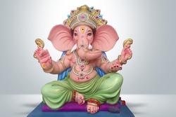 Hindu God Ganesha on grey background, Ganesha Idol.