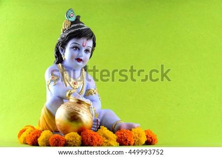 Hindu God Krishna on green background