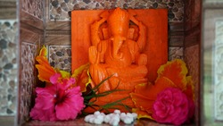Hindu god lord Ganesha idol, in a  marble temple. Beautiful red colored idol, the god of wisdom. Ganesha Chaturathi special.