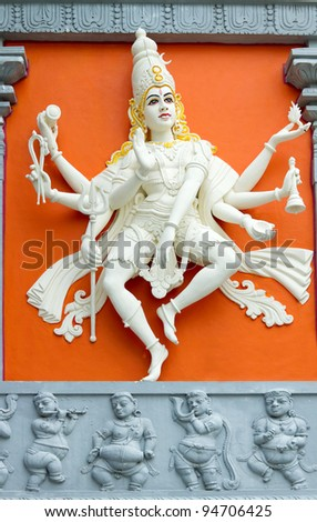 Hindu Goddess with Many Arms Statue on Wall of Sri Senpaga Vinayagar Temple