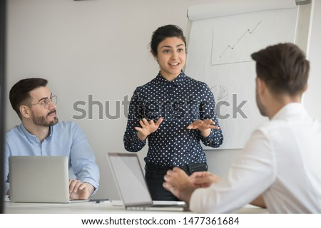 Hindu lady ceo negotiates with investors in boardroom. Business trainer give presentation explanation to company staff at seminar, corporate assistant provide information engaging participants concept