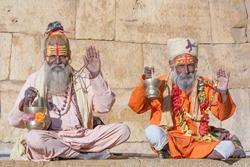 Hindu sadhu holy man, sits on the ghat