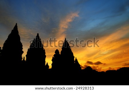 Hindu temple - Dramatic sky with sun setting at Hindu temple Prambanan. Indonesia, Central Java, Yogyakarta