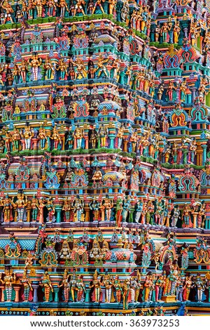 Hindu temple gopura (tower) with statues of deities close up. Menakshi Temple, Madurai, Tamil Nadu, India