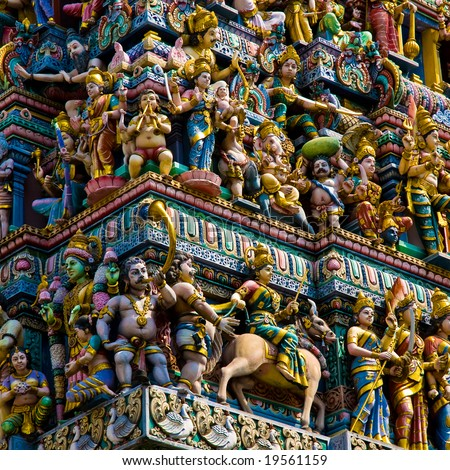 stock-photo-hindu-temple-in-singapore-crowded-with-statues-19561159.jpg