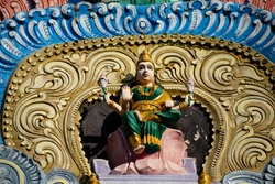 Hindu temple in Tamil Nadu, South India.  Sculptures on Hindu temple gopura (tower)
