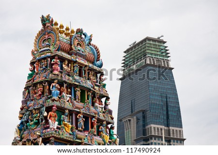 Hindu temple with modern building in the background, China Town, Singapore