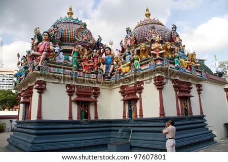 Hindu worshiper at Sri Mariamman Temple, Singapore