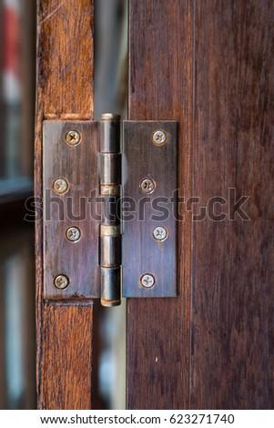 Hinges door wood interior detail. #623271740