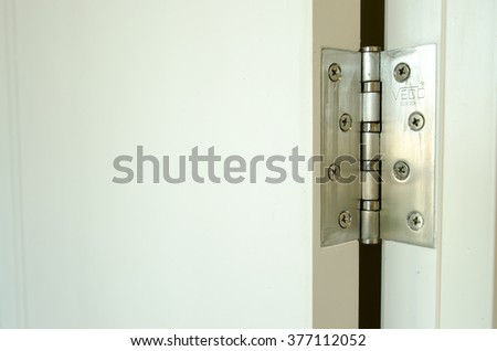 Hinges on the white door #377112052