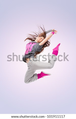 Hip-hop dancer girl posing making acrobatic movies - stock photo
