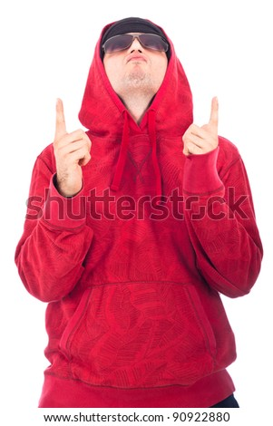 Hip Hop dancer in red hoody looking and pointing up. Isolated on white background.
