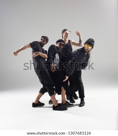 Hip hop dancers moving and jumping in photostudio #1307683126