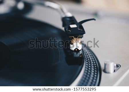 Hip hop dj turntable records player.Vintage analog turn table playing vinyl disc with music.Professional audio equipment for disc jockey.