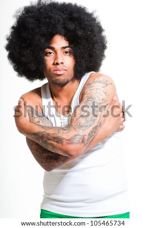Hip hop urban black man retro afro hair wearing white shirt and golden jewelry isolated on white. Looking confident. Cool guy. Studio shot.