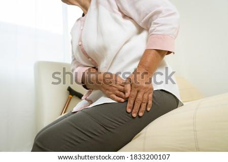 Hip pain of senior woman at home, healthcare problem of senior concept Stock fotó ©