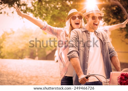 Hip young couple going for a bike ride on a sunny day in the city #249466726