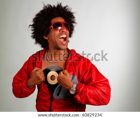 Hiphop artist posing with a vinyl record