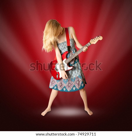 hippie girl with red electric guitar in dress