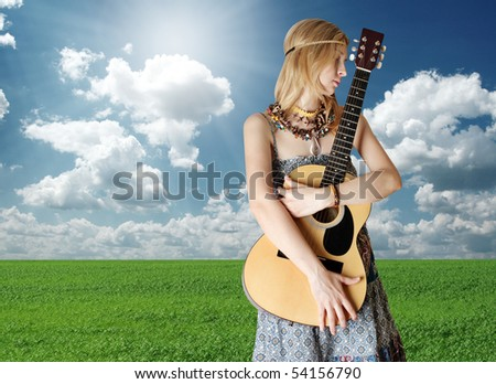 hippie girl with the guitar on openair rock festival