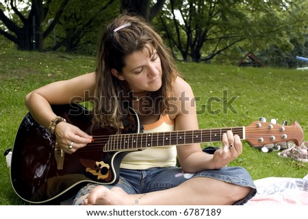 Hippie woman playing the guitar