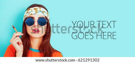Hippy girl smoking weed and wearing sunglasses, card