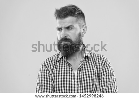Hipster appearance. Beard fashion and barber concept. Man bearded rustic hipster stylish beard yellow background. Barber tips maintain beard. Stylish beard and mustache care. Bearded and confident.