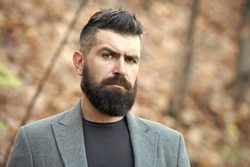 Hipster appearance. Man bearded hipster stylish fashionable coat. Stylish beard and mustache fall and winter season. Bearded and cool. Barber tips maintain beard. Beard fashion and barber concept.