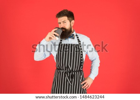 Hipster barista hold cup fresh brewed drip coffee. Coffee made by slowly pouring hot water through crushed beans in filter. Third wave is movement produce high quality coffee. Making best coffee.