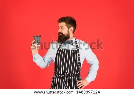 Hipster barista hold cup fresh brewed drip coffee. Making best coffee. Coffee made by slowly pouring hot water through crushed beans in filter. Third wave is movement produce high quality coffee.