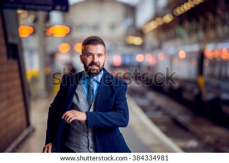 Hipster businessman at the staition running, catching the train #384334981