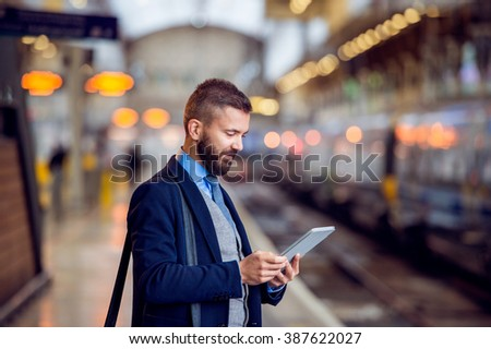 Hipster businessman with tablet, waiting, train platform #387622027